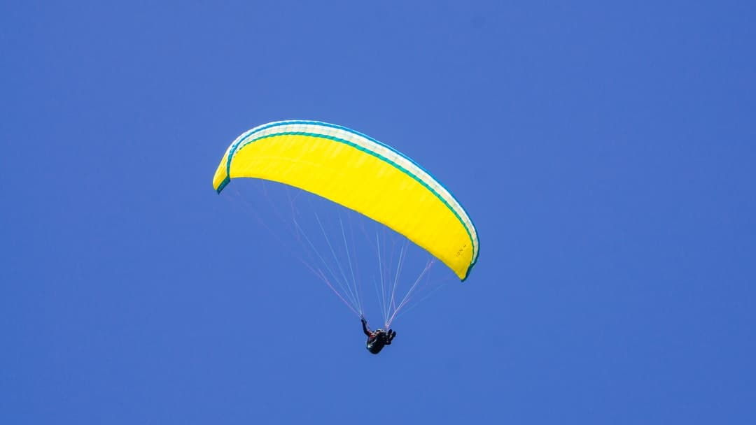 A parachute is flying in the air