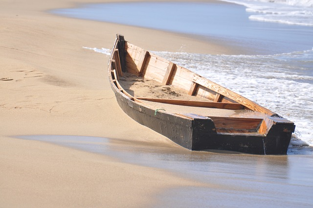 A wooden boat in a body of water